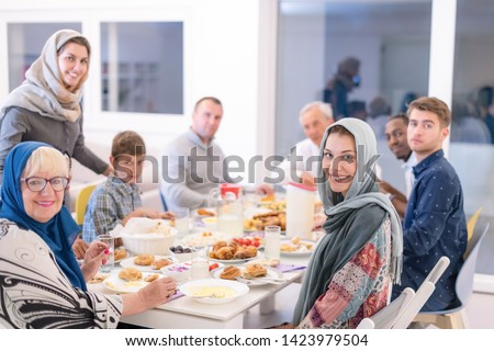 modern multiethnic muslim family enjoying eating iftar dinner together during a ramadan feast at home