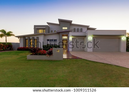 Modern multilevel house exterior at dusk