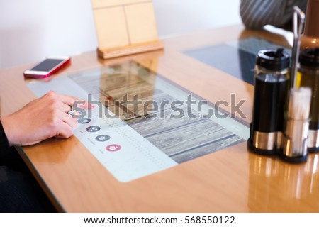 Modern multitouch-table in restaurant #568550122