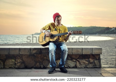 modern musician posing with his Spanish guitar
