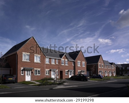 Modern new build street scene of terrace houses in the UK