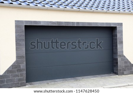 Modern new garage door (sectional door) #1147628450