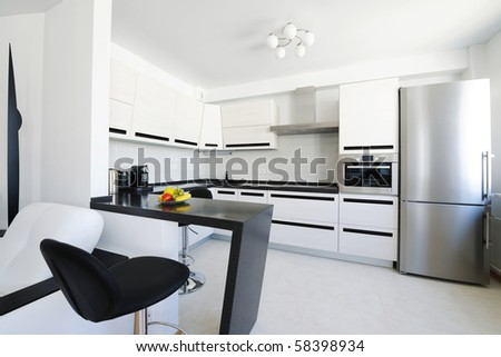 Modern new kitchen luxury interior. No brandnames or copyright objects.