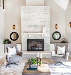 Modern new living room with fireplace and mirrors