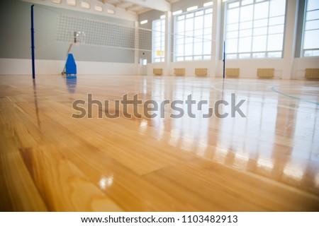Modern new school building. Empty school gymnasium with yellow floor and climbing near walls