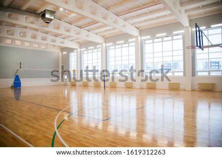 Modern new school building. Empty school gymnasium with yellow floor and climbing near walls Stock photo ©