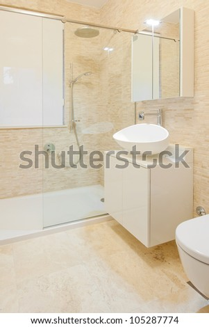 Modern new shower room with stone tiles