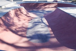 modern new skatepark ramps gray and pink red color empty skater