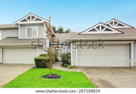 Modern northwest home with garage and grass yard.
