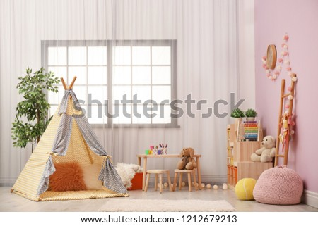 Modern nursery room interior with play tent for kids #1212679213