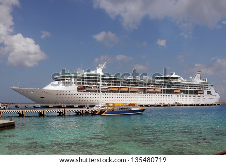 Modern ocean liner visiting Caribbean port of call