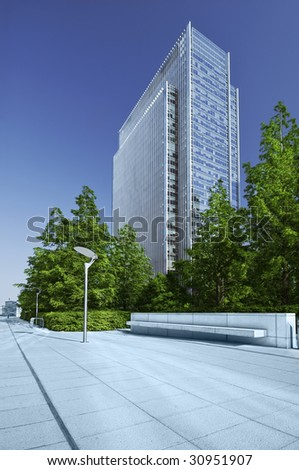 Modern office building and green park in London.