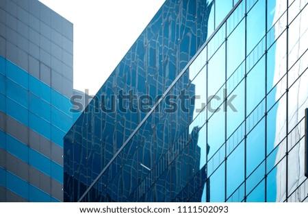Modern office building detail, glass surface  #1111502093