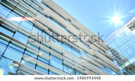 Modern office building detail, glass surface with sunlight #1486993448