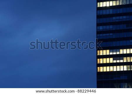 Modern office building in dusk. Useful file for your business site, annual report or other electronic or printed media.