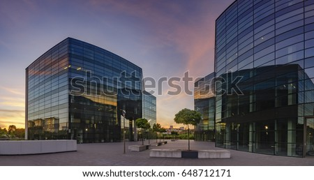Modern office building in the sunset light #648712171