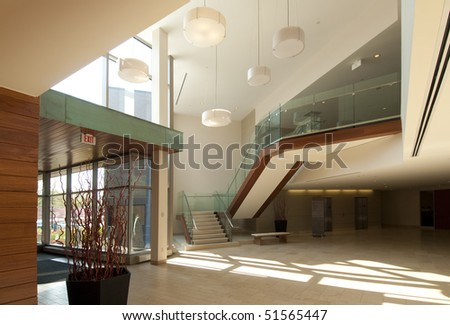 Modern office building lobby in marble, glass and mahogany - stock photo