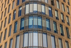 Modern office building. The appearance of new apartment buildings. The concept of real estate business. The facade of a modern business center. Windows in the business center.