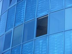 Modern office building with glass exterior, close-up