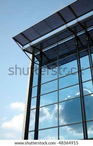 stock-photo-modern-office-building-with-reflection-of-sky-and-clouds-48364915.jpg