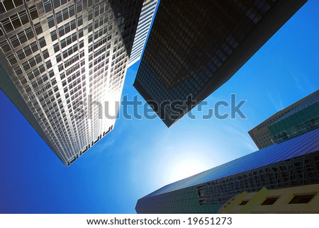 Modern office buildings in New York over blue sky