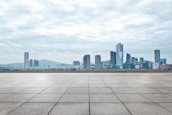 modern office buildings in seoul from empty brick floor in cloud sky