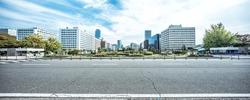 modern office buildings in seoul in cloud sky from empty road