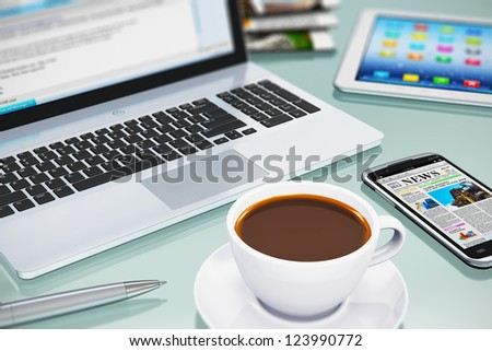 Modern office business workplace with laptop PC, touchscreen smartphone, tablet computer and white porcelain cup of black coffee. Selective focus effect
