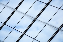 modern office glass windows with sky reflection
