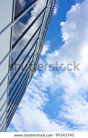 Modern office house. blue glass on a background sky #99343745