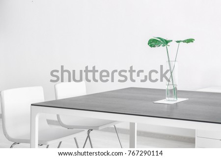 Modern office interior with big table and white chairs #767290114