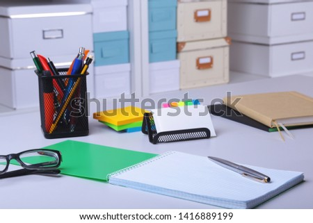 Modern office interior with tables, chairs and bookcases #1416889199