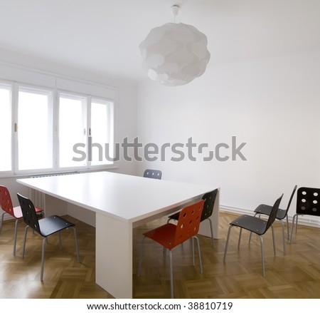 modern office with table and chairs