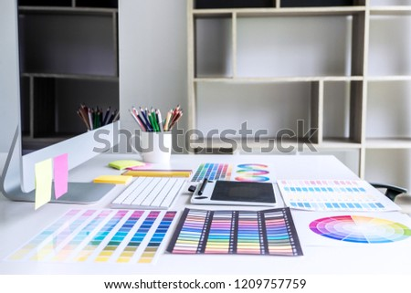 Modern office workplace with tablet, Graphic designer and color swatch samples at workplace. #1209757759