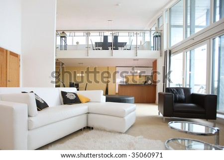 Modern Open-Plan Apartment. Living Room In Foreground With Kitchen ...