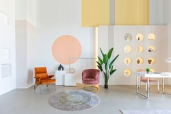 modern open-plan room interior in futuristic style in pastel colors with graphic wall decoration. very high ceilings and a huge window. soft stylish furniture with gold metallic elements