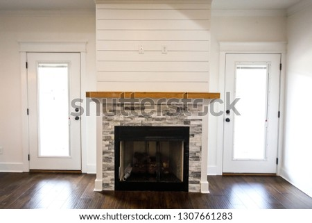 Modern Open Spacious Living Room With Tiled Fireplace and Custom Mantle and Dark Wood Floors