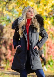 Modern outfit for youth. Girl in warm coat stand in park nature background defocused. Woman long blonde hair wear stylish outfit with parka. Create fall outfit to feel comfortable and pretty.