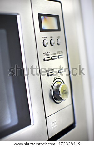 Modern oven control panel close up with buttons and knob close up of a modern kitchen #472328419