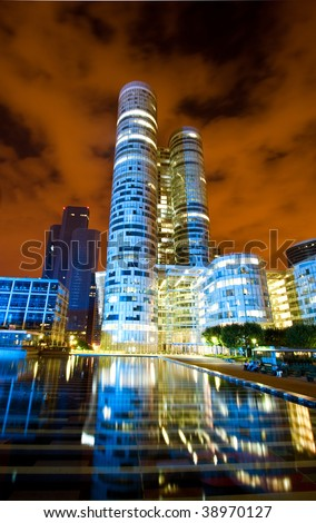 Modern paris architecture at night, wide angle perspective