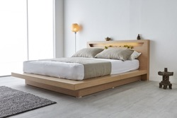 Modern peaceful Bedroom. zen style bedroom. Peaceful and serene bedroom. Wood bed with oriental object.led bed.