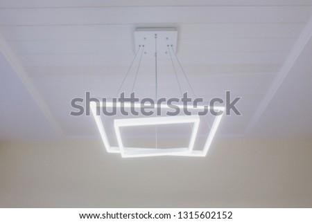 Modern Pendant light lamp illuminated, Elegant Chandelier illuminated. #1315602152