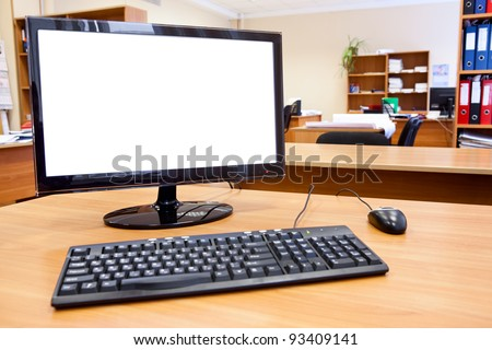Modern personal computer on desktop in office room