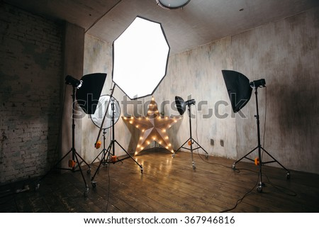 Modern photo studio interior with professional lighting equipment #367946816