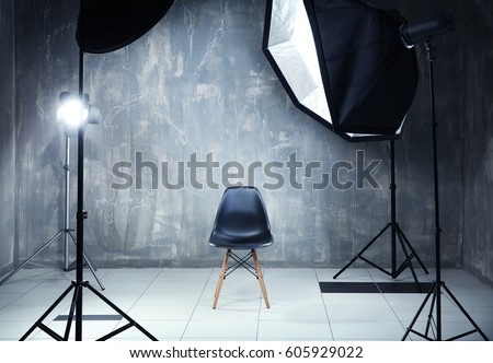 Modern photo studio interior with professional lighting equipment #605929022