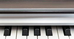 modern piano synthesizer octave with white and black keyboard keys at dress rehearsal before concert close view