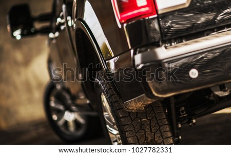 Modern Pickup Truck Shallow Depth of Field Photo. Vehicle Rear. Focusing on the Tire.