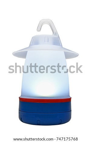 Modern plastic camping light on table illuminated and isolated #747175768