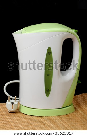 Modern plastic upright kettle isolated on black background