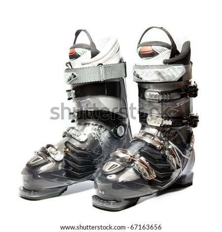 Modern professional ski boots on white background